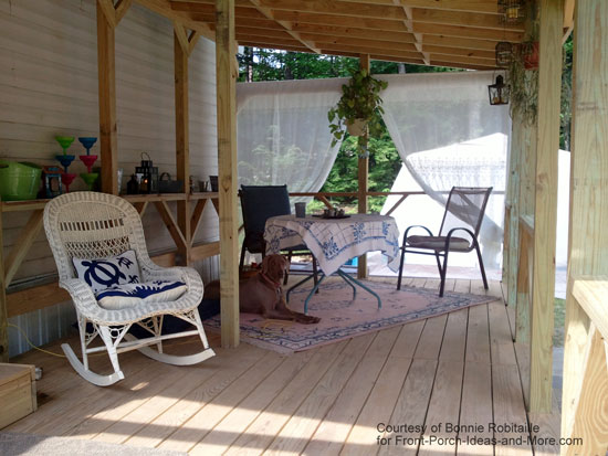 Mobile Home Porch With Exposed Rafters And Porch Furniture