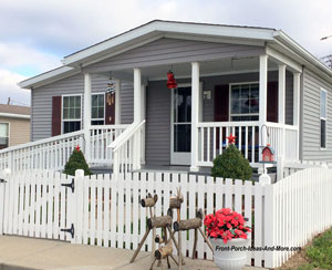 exterior shutters on manufactured home with front porch and ramp