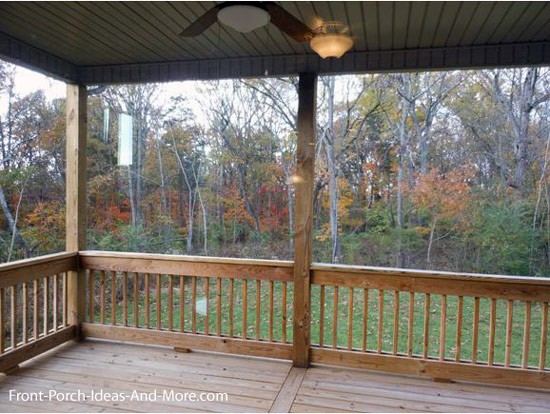 covered back deck with outdoor fan on model home
