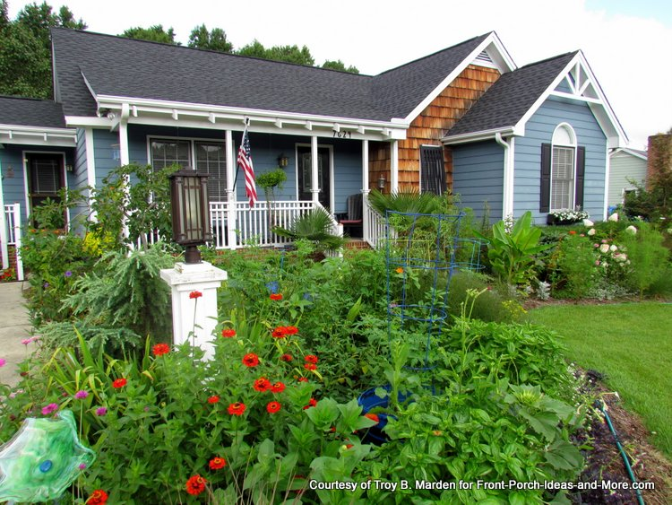 what a wonderful home with a porch that overlooks an amazing garden