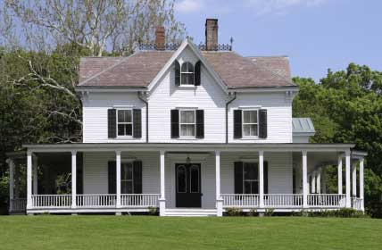 large wrap around farm house country porch on hill