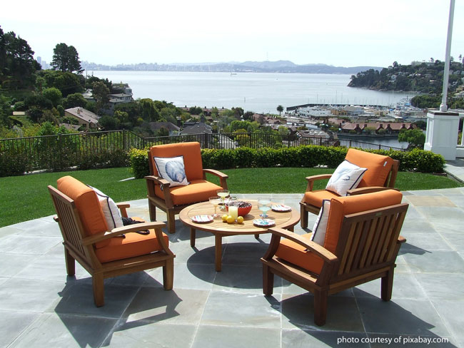 patio with outdoor furniture overlooking landscape