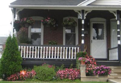 Northeastern porch of a twin brick home