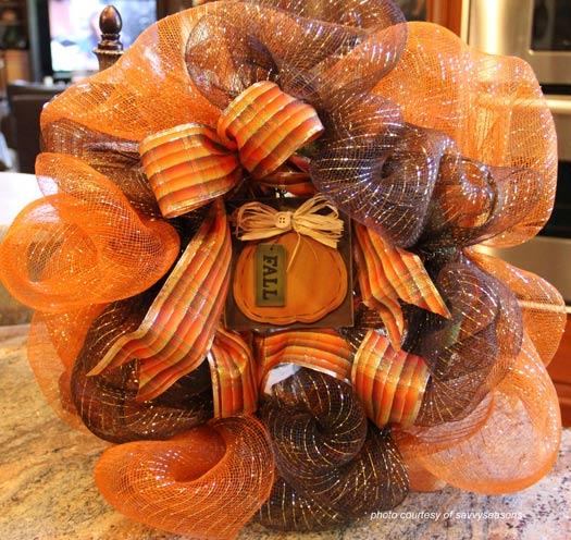 front door wreath made with Halloween orange ribbon