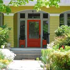 orange front door on front porch