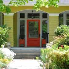 orange front door on front porch