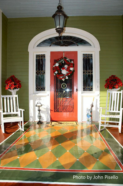 beautifully painted porch floor and front door wreath