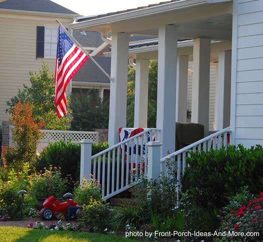 Old Glory on hometown front porch