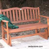 Wood glider with soft green throw for coziness