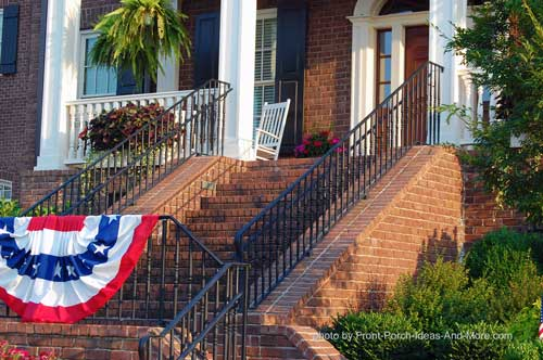 Beautiful iron outdoor hand rails on patriotic front porch