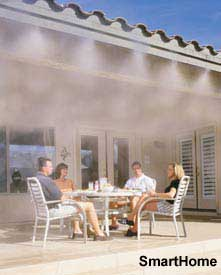 outdoor mister on back porch helps to cool the people sitting around the table