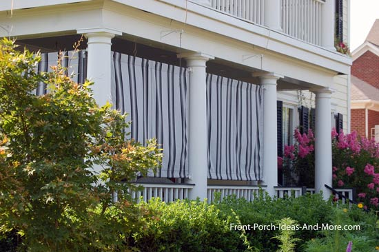striped outdoor curtains on front porch
