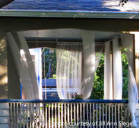 outdoor porch curtains blowing in the breeze