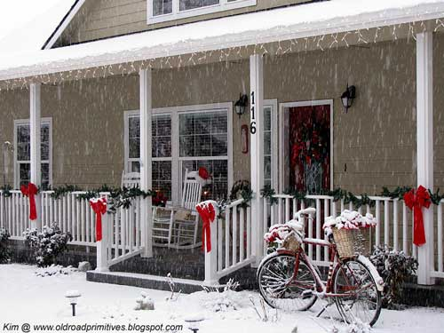 snowy front porch and outside christmas decorations