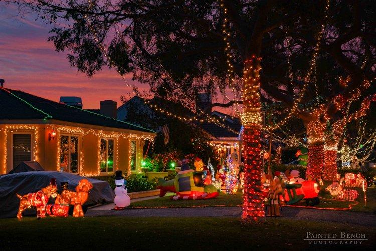 vibrant display of Christmas lights and inflatables