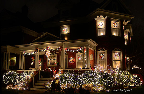 older house decorated with Christmas lights