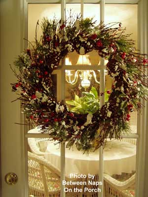 Susan's Christmas wreath decorations - wreath hanging on screened porch