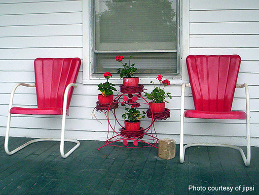 Retro red metal chairs on country porch