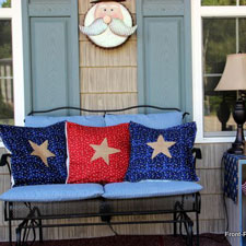 patriotic pillow covers on front porch