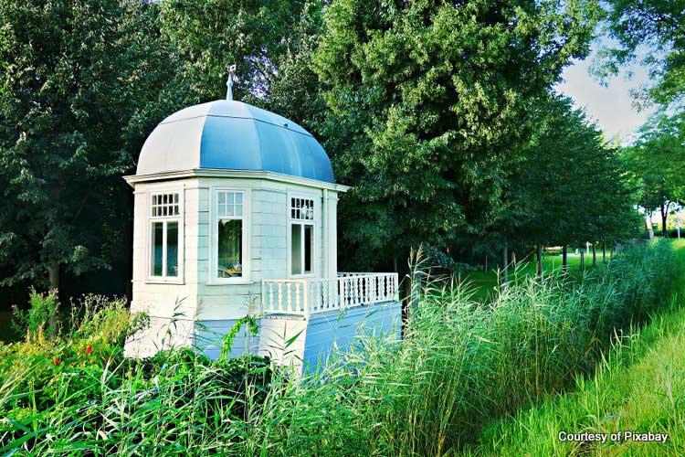 private backyard gazebo that is enclosed