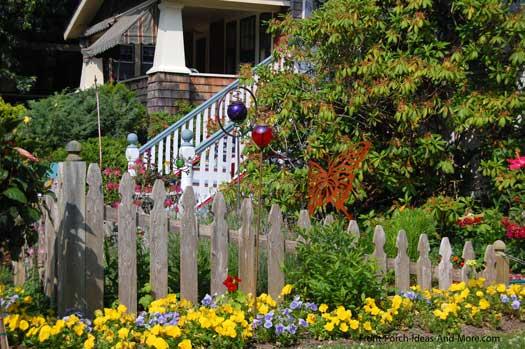 picket fence amongst flower gardens