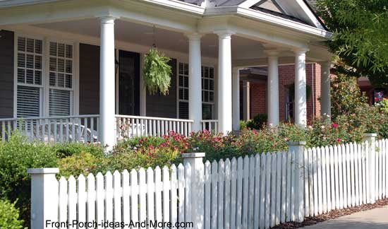 picket fence used in front of flowering shrubs