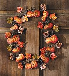 pumpkin adorned front door wreath for autumn