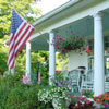 American flag flying from front porch