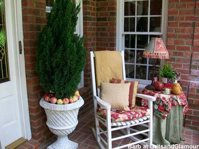 front porch decorating ideas - corner of Barb's porch with rocking chair and table