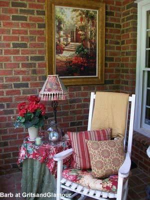 Barb's brick front porch - lovely rocking chair, side table and wall art