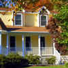 yellow front porch on two story home