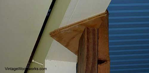 Raise the beam just enough to be able to chisel out the old porch flooring under the post.