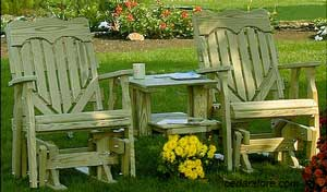 Wooden porch gliding chairs with table in-between