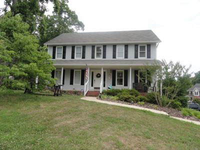 two story farmhouse with large porch
