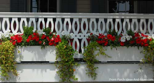 sawn porch balusters in loop pattern create a nice backdrop for the flower boxes