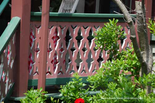 sawn railings in shades of pink and turquoise on this Victorian home