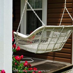comfortable country porch wicker swing