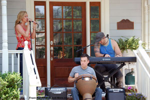 musical group performing on porch at porchfest