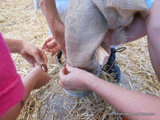 tie off burlap at bucket