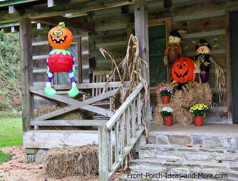 decorative pumpkins on log cabin porch