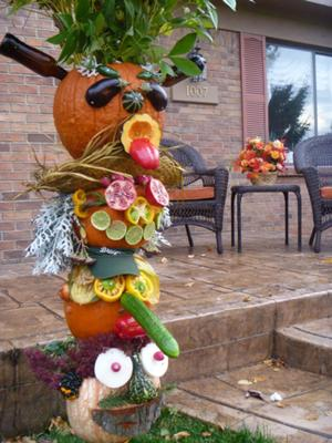 pumpkin decked out with fruit and veggies