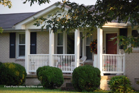 colonial style porch railings on ranch home