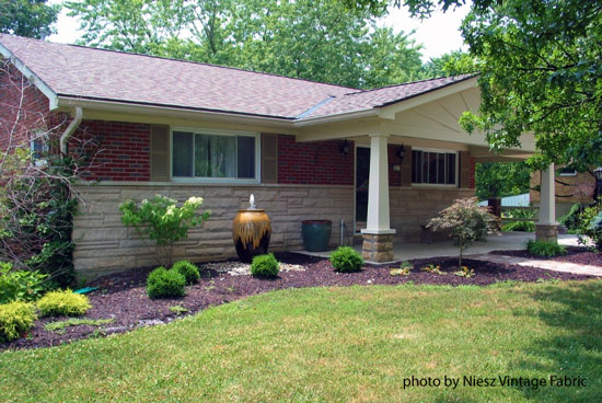 remodeled ranch home with gabled front porch