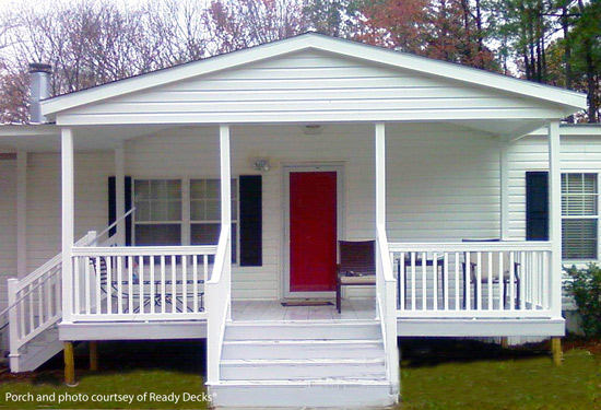 white front porch with red door on manufactured home