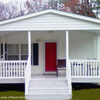 mobile home front porch with bright red door