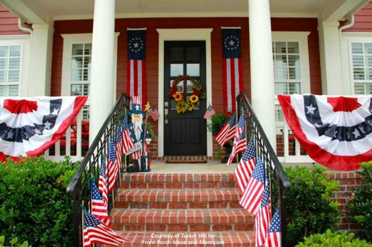 Gorgeous red home with patriotic buntings