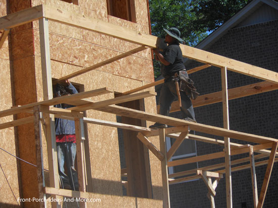 Installing beams to support roof trusses
