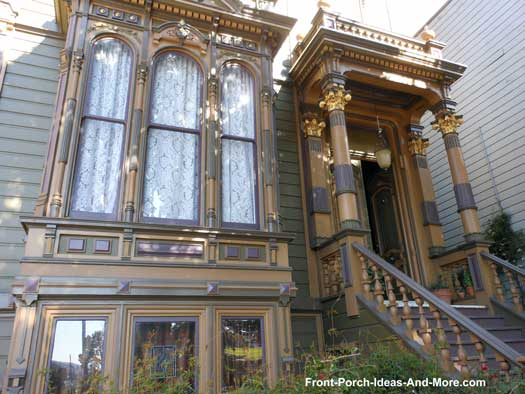 front porch with gilded porch columns and trim