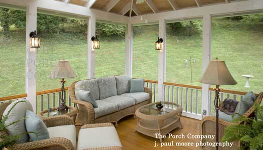 outdoor lamps and sconces add ambiance on this enclosed porch
