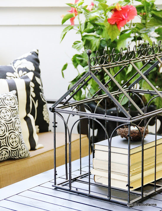 books in birdcage on table